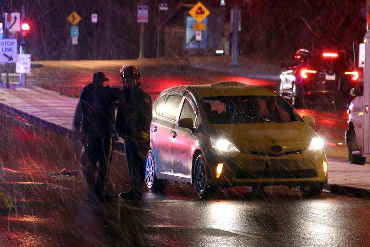 Surrey woman in hospital after stepping in front of cab