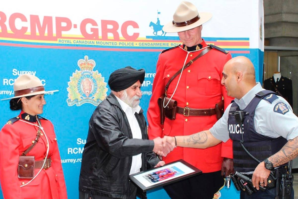 "431dcb6a Surrey RCMP put a call out to the public to help identify ""Mr. Brar""  (second from left) who waited in line at the Surrey Vaisakhi Parade to have  the "" ..."